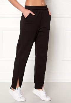 CHEAP MONDAY Haste Trousers Black Bubbleroom.fi